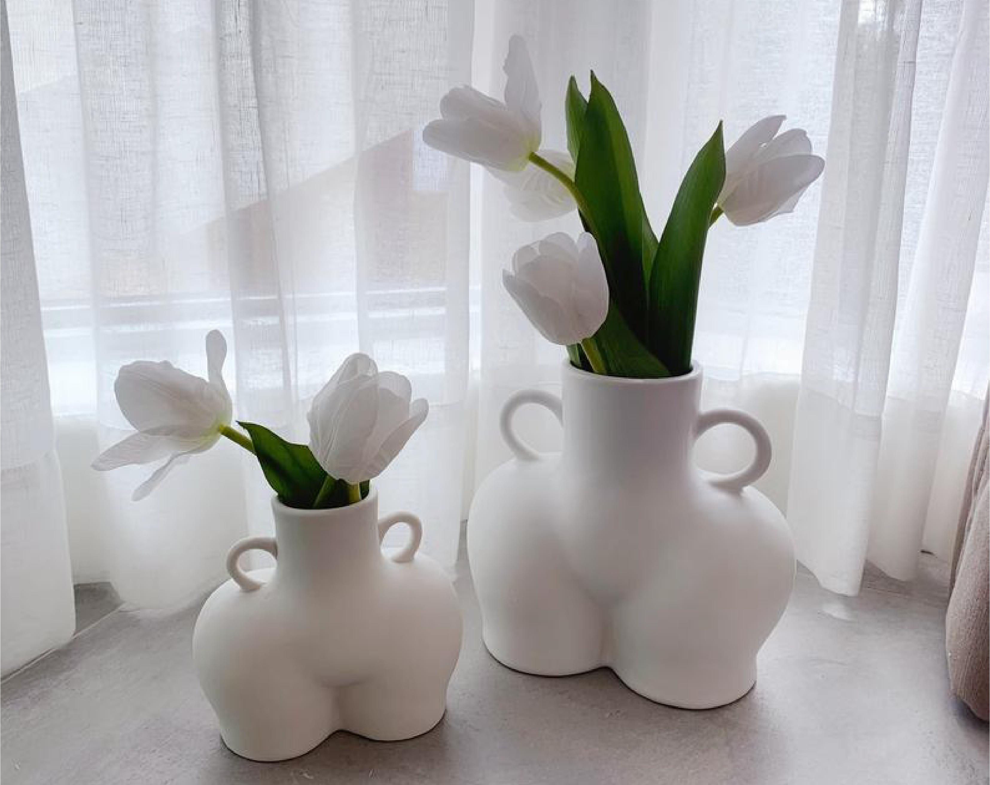 Female figure vases
